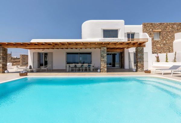 Swimming pool and an outdoors shaded area by the Villa Meli in Mykonos.