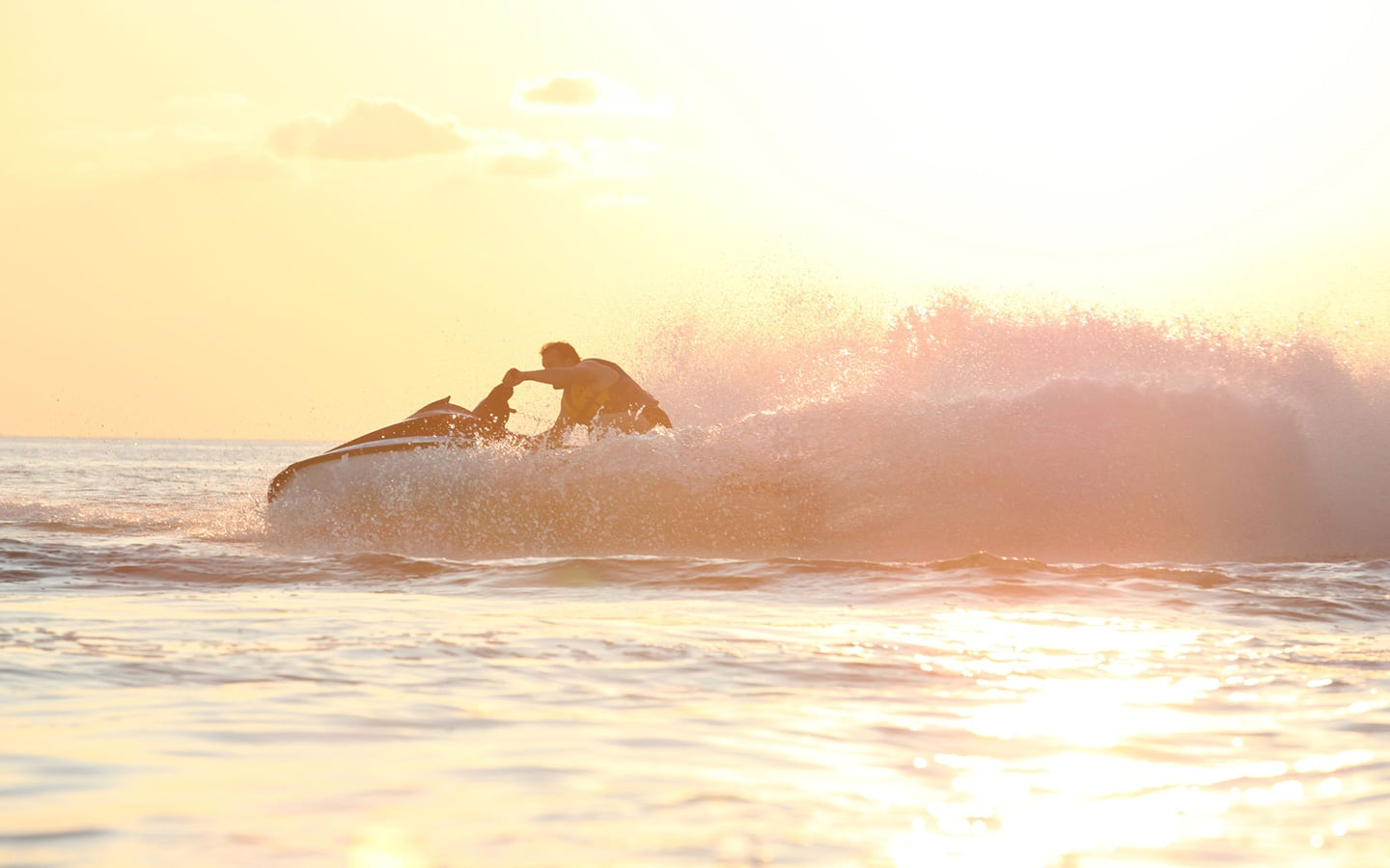 A man in jet ski during the sunset. Activities & Water Sports in Mykonos.