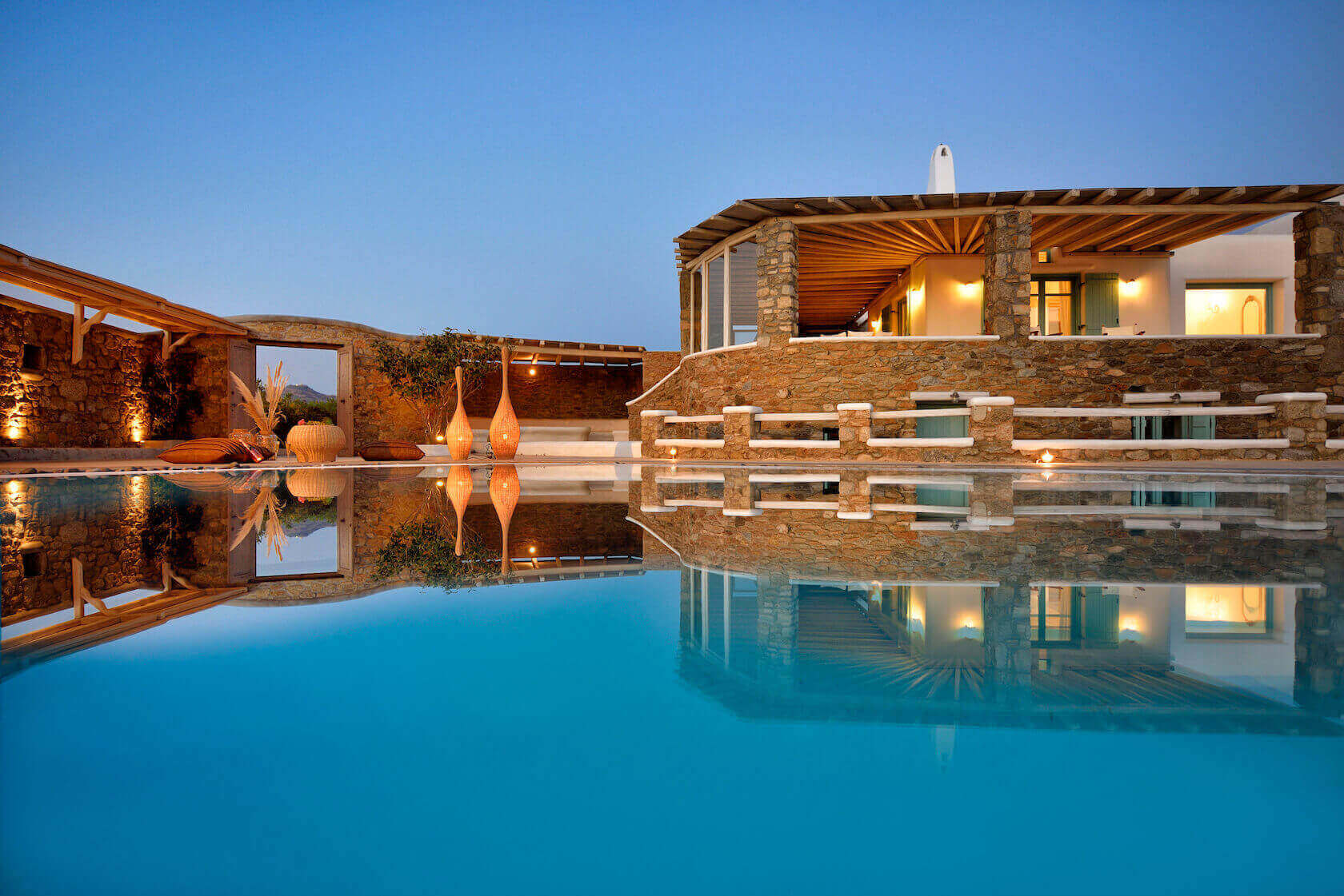 Crystal clear swimming pool in Villa Irida in Mykonos. The exterior of the villa.
